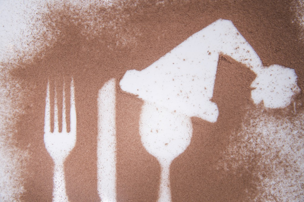 Representation of the Christmas holiday with cutlery on the plate and a dusting of cocoa